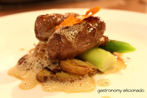 Beef involtini with Tuscany style of potatoes, asparagus, and foie gras emulsion