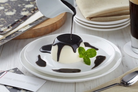 Pannacota with black sesame sauce