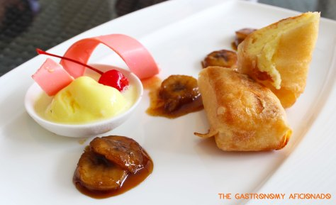 Cheese cake fritters with vanilla ice cream and banana flambe