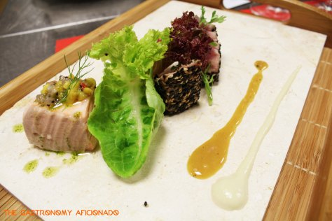 Poached salmon, tuna tataki, honey lemon vinaigrette and chili