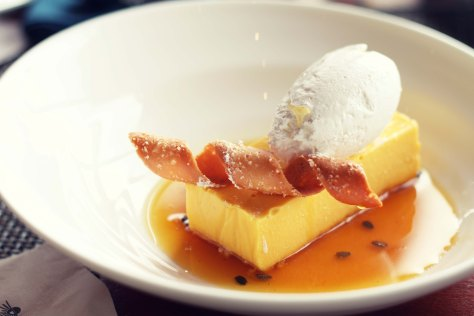 Mango Cheesecake with Coconut Whipped Cream, Passion Fruit Sauce and Coconut Tuile