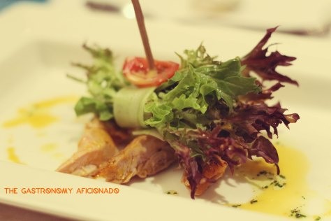 Roasted chicken Bacolod-style, Davao's pomelo, mixed greens, and sinamak annatto vinaigrette