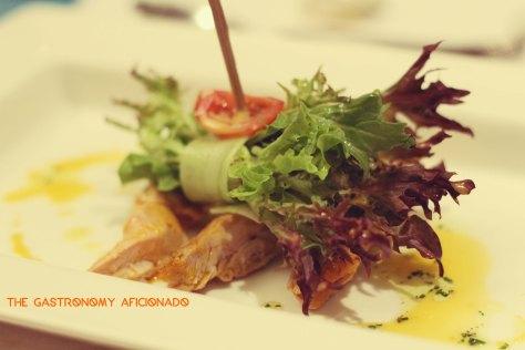 Roasted chicken Bacolod-style, Davao's pomelo, mixed greens, and sinamak annatto vinaigrette