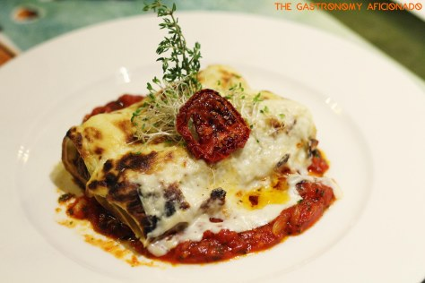 Baked cannelloni stuffed with lamb, artichoke and pine nuts