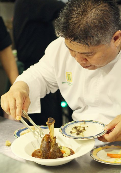 Attention to detail. Chef Deden decorates the magnificent braised lamb foreshank.