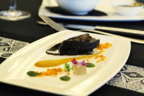 Veal cheek with deconstructed rawon sauce by Petty Elliott